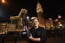 Qing Liu poses with her first title.  WPT